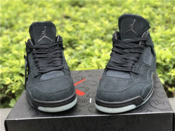 KAWS x Air Jordan 4 in Black front