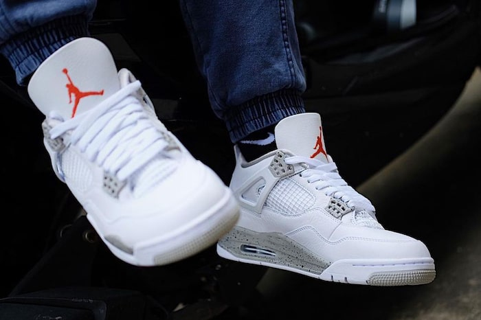 2021 Air Jordan 4 White Oreo on feet