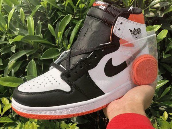 Air Jordan 1 High OG GS Electro Orange on hand close look