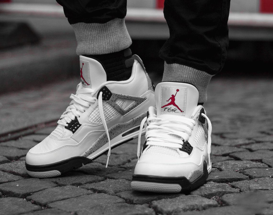 Air Jordan 4 White Oreo on foot sneaker