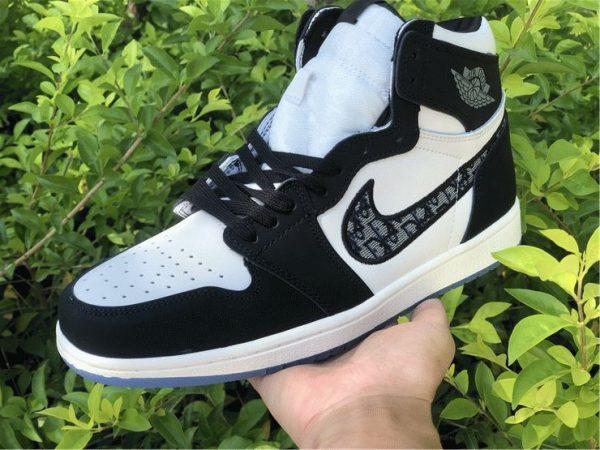 Dior x Air Jordan 1s Black White on hands